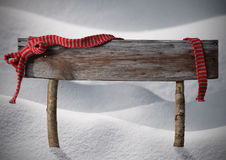 Brown Christmas Sign Copy Snow, Red Ribbon, Snowflakes. Brown Wooden Christmas Sign On White Snow. Snowy Scenery. Red Ribbon, Copy Space For Advertisement stock image