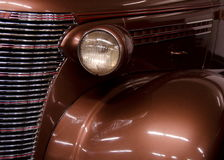 Brown and chrome details of front design of a classic car.  Royalty Free Stock Photography