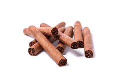 Brown cigar burned on white background Stock Photos