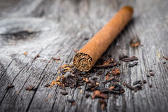 Brown cigar on grey wooden table Stock Images