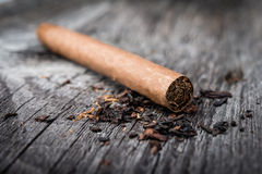 Brown cigar on grey wooden table Stock Photos