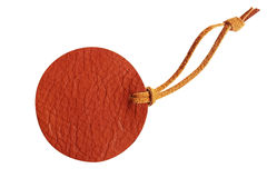 Brown circle leather price tag with leather cord isolated on whi Stock Photo