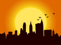 Brown city in the sunrise. Silhouette of brown city in the sunrise Stock Image