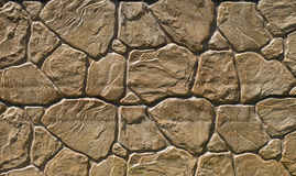 Brown cladding tiles imitating stones Stock Images