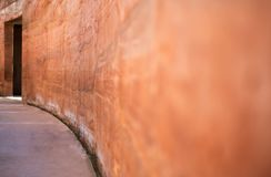 Brown clay blur wall beside of walkway Stock Photo
