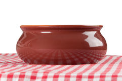 Brown clay bowl on the table Royalty Free Stock Photo