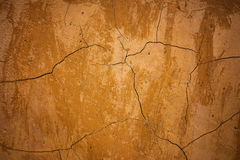 Brown clay earthen wall texture or background. Beautiful brown clay earthen wall texture or background royalty free stock photo