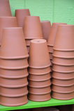 Brown clay flower pots. Stacks of brown clay flower pots in garden greenhouse Stock Photography