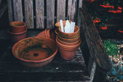 Brown Clay Plant Pots on Black Wooden Armchair Stock Photos