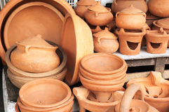 Brown clay pots on market Royalty Free Stock Image