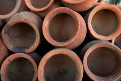 Brown clay pots, photo above, the structure circles background. Royalty Free Stock Image
