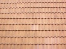 Brown clay roof tiles. Closeup of the brown clay roof tiles Stock Photo