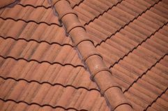 Brown clay roof tiles. Closeup of the brown clay roof tiles Royalty Free Stock Photography