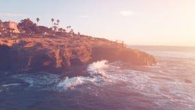 Brown Cliff Beside Ocean Under Blue Sky Royalty Free Stock Image