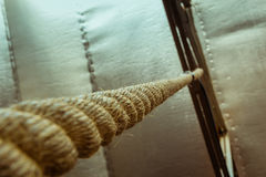 Brown climbing rope hanging from roof Royalty Free Stock Photography