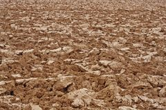 Brown clods of earth in a field just plow Royalty Free Stock Photo