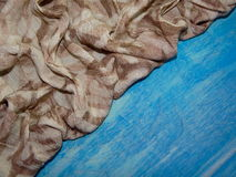 Brown cloth with drawings Stock Photos