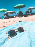Brown Clubmaster Sunglasses on Blue Towel stock photos