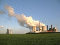 Brown coal fired power station. And new building beside sthem Stock Image
