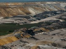 Brown coal mine spoil scenery. Mine spoil scenery in an open pit Royalty Free Stock Photography