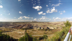 BROWN COAL OPEN-CAST MINING 01. Brown coal open-cast mining with fired power station - panorama Stock Image