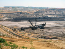 Brown coal open pit. Bucket-wheel excavator in an open pit Royalty Free Stock Photography