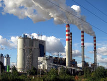 Brown-coal power plant with chimney giving off large amounts of Stock Photography