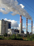 Brown-coal power plant with chimney giving off large amounts of Royalty Free Stock Photo