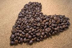 Brown Coffee Bean in Heart Shaped Stock Image