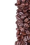 Brown coffee beans. Isolated on white background. Copy space on left Royalty Free Stock Photo