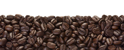 Brown coffee beans. Close-up of coffee beans for background and texture royalty free stock photos