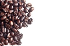 Brown coffee beans. Brown coffee beans on white background Royalty Free Stock Photo