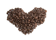 Brown coffee beans, close-up of coffee beans hearts Royalty Free Stock Photo