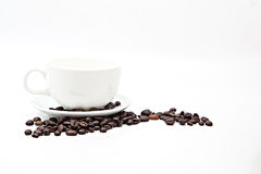 Brown coffee beans and coffee cup isolated Royalty Free Stock Photos