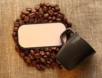 Brown coffee beans with cup Stock Photos
