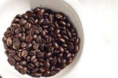 Brown coffee beans in cup ,Isolated white. Background, texture stock photo