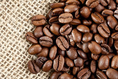 Brown Coffee Beans on a jute bag. Royalty Free Stock Photography