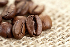 Brown Coffee Beans on a jute bag. Stock Photo