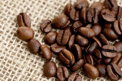 Brown Coffee Beans on a jute bag. Royalty Free Stock Photos