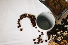 Brown Coffee Beans Near White Ceramic Mug Royalty Free Stock Photography