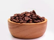 Brown coffee beans. Brown coffee beans, Put it in a wooden bowl. Space for placing text Royalty Free Stock Photography