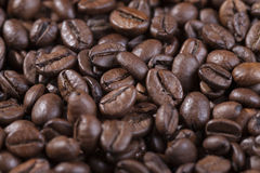 Brown coffee beans. Spread roasted coffee beans on the table Royalty Free Stock Photography