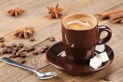 Brown coffee cup on the background of wooden planks Stock Photography