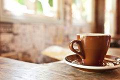Brown coffee cup in a cafe Stock Photo