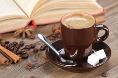 Brown coffee cup r on the background of wooden planks Stock Photos