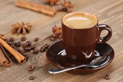 Brown coffee cup r on the background of wooden planks Royalty Free Stock Photo