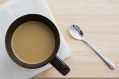 Brown coffee cup top view. Brown coffee cup on a wooden table top view Stock Photo