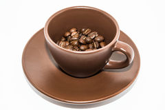 Brown Coffee And Cup On White Backgrounds Royalty Free Stock Photo