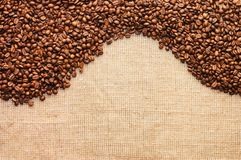 Brown coffee grains on a sacking Royalty Free Stock Photo