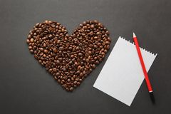 Brown coffee solated on black texture background for design. Saint Valentine`s Day card on fabruary 14, holiday concept. stock image